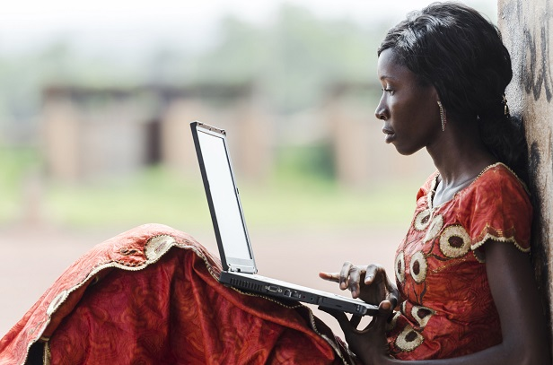 Woman with a laptop on her lap